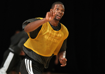 Hi-res-183586315-chris-bosh-of-the-miami-heat-participates-in-training_display_image