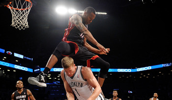 Hi-res-185159350-eric-griffin-of-the-miami-heat-jumps-over-mason-plumlee_display_image