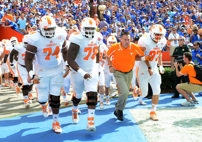 Hi-res-181483866-coach-butch-jones-of-the-tennessee-volunteers-leads-the_crop_650