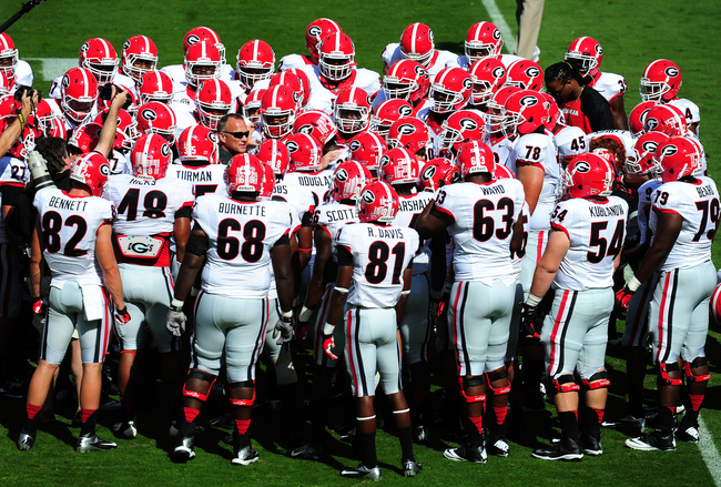 Hi-res-183167162-head-coach-mark-richt-of-the-georgia-bulldogs-huddles_crop_650