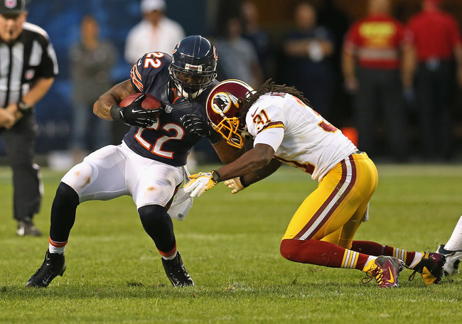 Hi-res-150464890-matt-forte-of-the-chicago-bears-is-hit-by-brandon_crop_650
