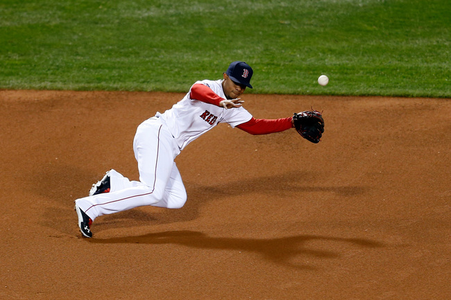 Hi-res-185369463-xander-bogaerts-of-the-boston-red-sox-miss-a-catch-hit_crop_650