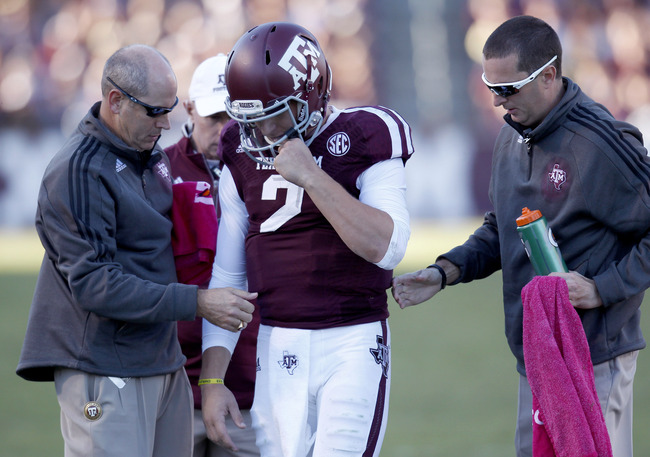 Hi-res-185369444-medics-attend-johnny-manziel-of-the-texas-a-m-aggies_crop_650