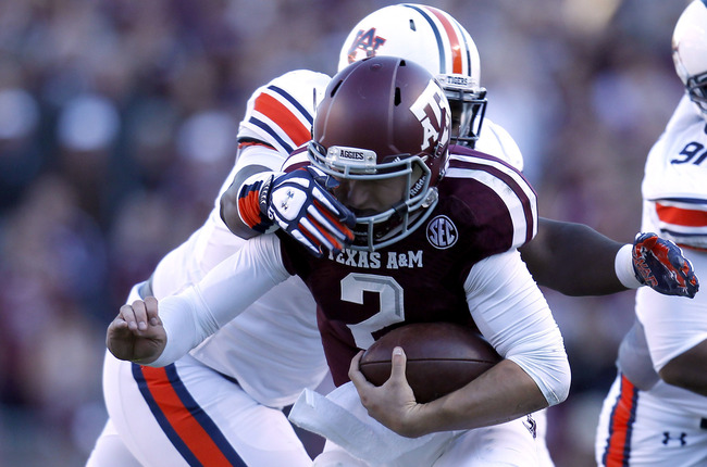 Hi-res-185369445-johnny-manziel-of-the-texas-a-m-aggies-is-tackled-by_crop_650