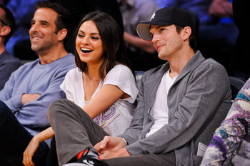 Hi-res-161609232-actors-mila-kunis-and-ashton-kutcher-attend-a-game_display_image