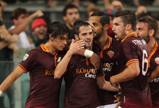 Hi-res-185259512-miralem-pjanic-with-his-team-mates-dodo-and-kevin_crop_650x440