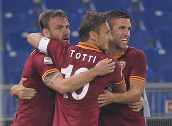 Hi-res-182535672-alessandro-florenzi-with-his-team-mates-daniele-de_display_image