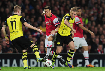 Hi-res-185579455-jakub-blaszczykowski-of-borussia-dortmund-and-mesut_display_image
