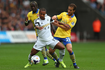Hi-res-182113056-wayne-routledge-of-swansea-city-is-crowded-out-by_display_image