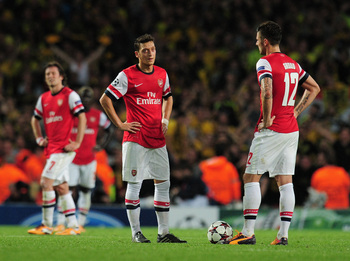 Hi-res-185588035-mesut-ozil-and-olivier-giroud-of-arsenal-react-after_display_image