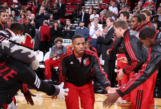 Hi-res-183953666-damian-lillard-of-the-portland-trail-blazersruns-out_crop_650x440