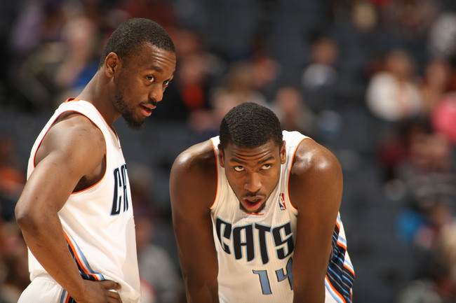 Hi-res-164759466-kemba-walker-and-michael-kidd-gilchrist-of-the_crop_650