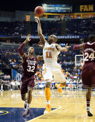 Hi-res-163691539-trae-golden-of-the-tennessee-volunteers-shoots-the-ball_display_image
