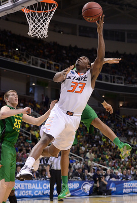 Hi-res-164287060-marcus-smart-of-the-oklahoma-state-cowboys-shoots_display_image