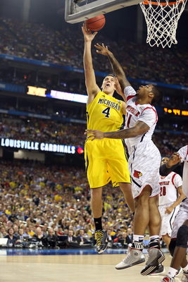 Hi-res-166733667-mitch-mcgary-of-the-michigan-wolverines-attempts-a-shot_display_image