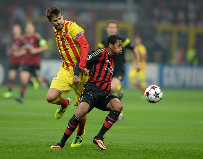 Hi-res-185579162-robinho-of-ac-milan-and-gerard-pique-of-fc-barcelona_crop_650