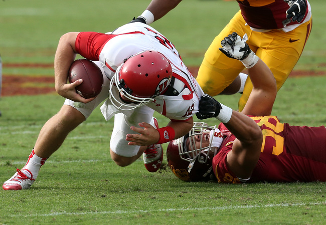 Hi-res-185964409-defensive-end-j-r-tavai-of-the-usc-trojans-pulls-down_crop_650
