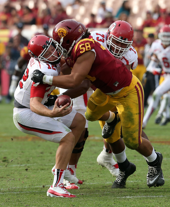 Hi-res-185964581-defensive-end-j-r-tavai-of-the-usc-trojans-pulls-down_crop_650