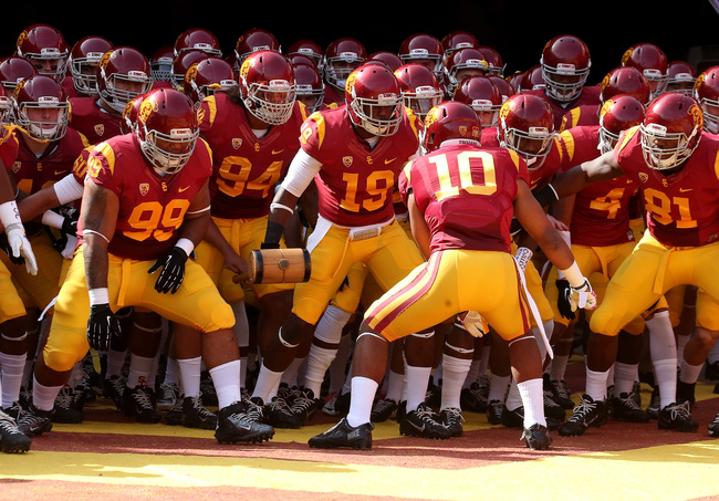 Hi-res-185968581-the-usc-trojans-get-ready-to-run-out-of-the-tunnel-for_crop_650