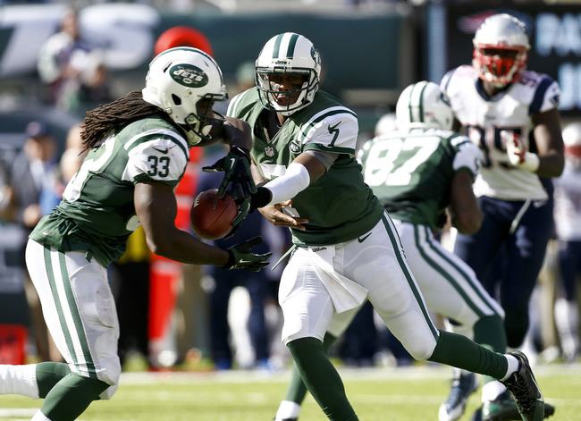 Hi-res-185422263-geno-smith-off-to-chris-ivory-of-the-new-york-jets_crop_650