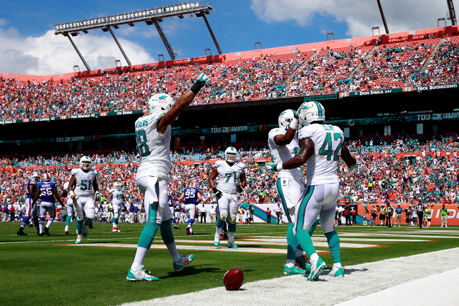 Hi-res-185422053-charles-clay-of-the-miami-dolphins-is-congratulated-on_crop_650
