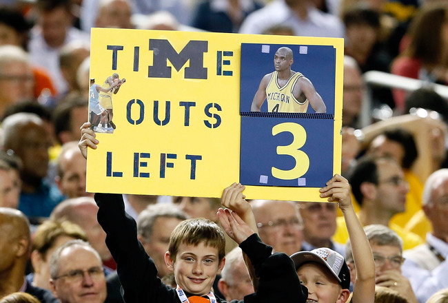 Hi-res-165882288-fan-holds-up-a-sign-which-reads-as-a-timeout-counter-in_crop_650x440