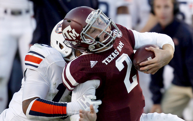 Hi-res-185369431-johnny-manziel-of-the-texas-a-m-aggies-is-tackled-by_crop_650