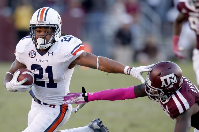 Hi-res-185369479-tre-mason-of-the-auburn-tigers-rushes-against-deshazor_crop_650