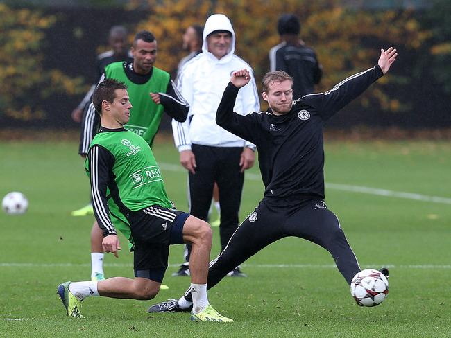 Hi-res-185469328-andre-schurrle-looks-to-intercept-cesar-azpilicuetas_crop_650
