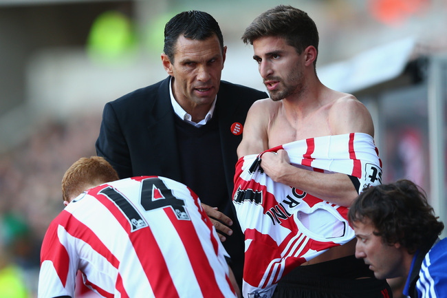 Hi-res-185395030-gus-poyet-the-manager-of-sunderland-passes-on_crop_650