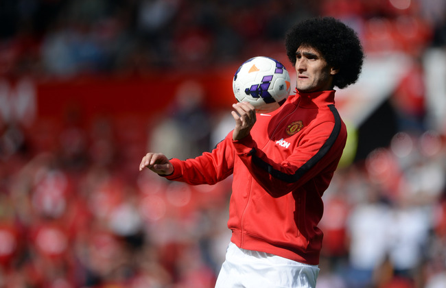 Hi-res-180518653-marouane-fellaini-of-manchester-united-warms-up-prior_crop_650