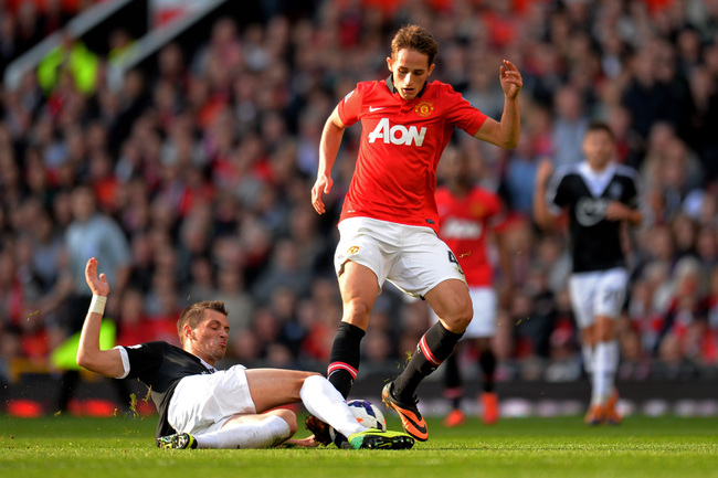 Hi-res-185347206-adnan-januzaj-of-manchester-united-is-tackled-by-morgan_crop_650