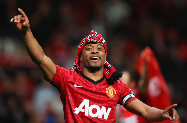 Hi-res-167256390-patrice-evra-of-manchester-united-celebrates-victory_crop_650