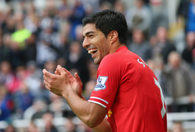 Hi-res-185346430-luis-suarez-of-liverpool-claps-during-the-barclays_crop_650x440