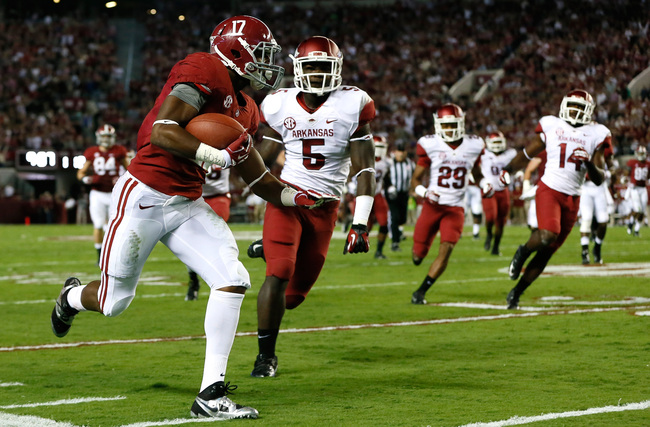 Hi-res-185369682-kenyan-drake-of-the-alabama-crimson-tide-rushes-past_crop_650