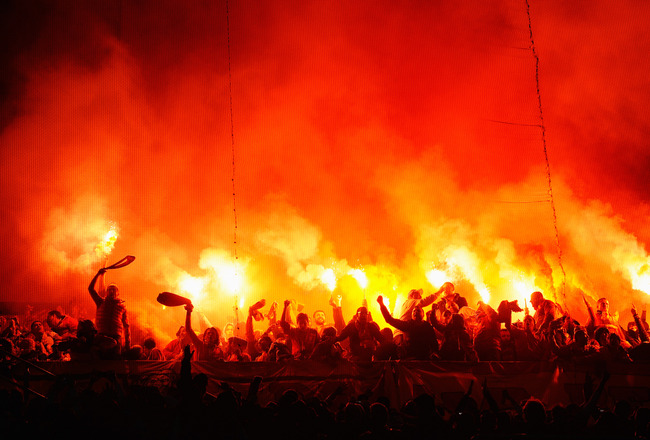 Hi-res-165360465-galatasaray-fans-light-flares-during-the-uefa-champions_crop_650x440