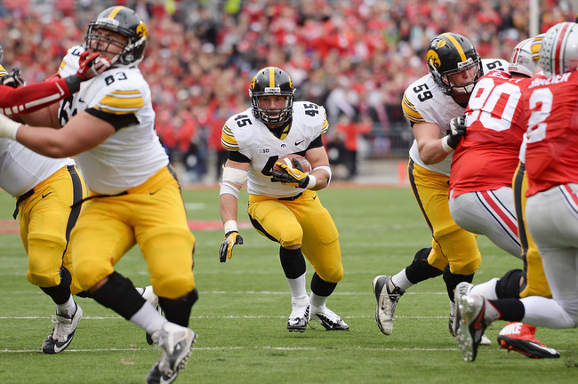 Hi-res-185364559-mark-weisman-of-the-iowa-hawkeyes-hits-the-hole-looking_crop_650