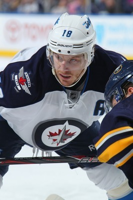 Hi-res-168323644-bryan-little-of-the-winnipeg-jets-takes-a-faceoff_display_image