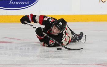 Hi-res-185359212-cory-conacher-of-the-ottawa-senators-looks-to-complete_display_image