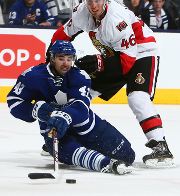 Hi-res-183196291-nazem-kadri-of-the-toronto-maple-leafs-gets-brought_display_image