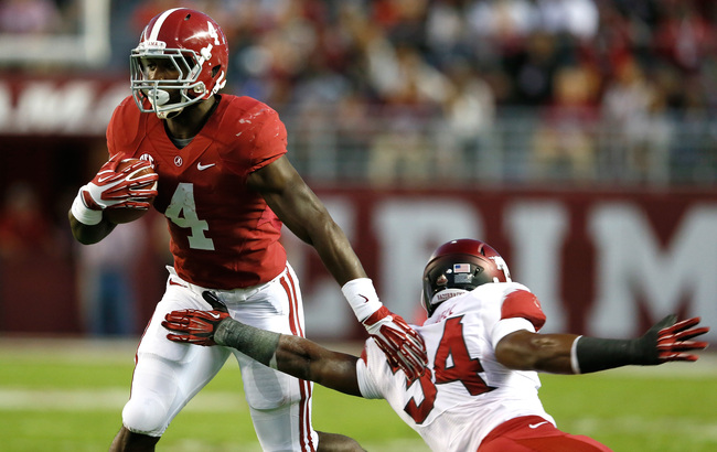 Hi-res-185373247-yeldon-of-the-alabama-crimson-tide-breaks-a-tackle-by_crop_650