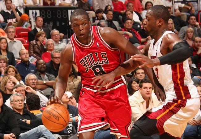Hi-res-80149186-luol-deng-of-the-chicago-bulls-dribbles-against-dwyane_crop_650