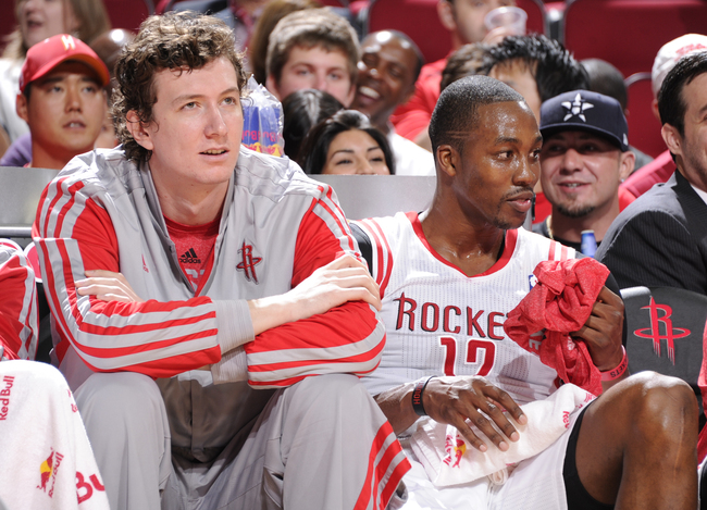 Hi-res-183643332-dwight-howard-and-omer-asik-of-the-houston-rockets_crop_650