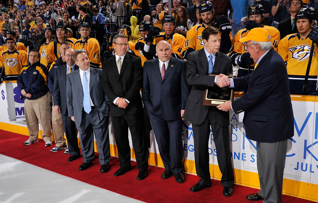 Hi-res-142486733-chairman-tom-cigarran-presents-gm-david-poile-of-the_crop_650