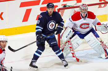 Montreal Canadiens goalie Carey Price and Winnipeg Jets forward Devin Setoguchi.