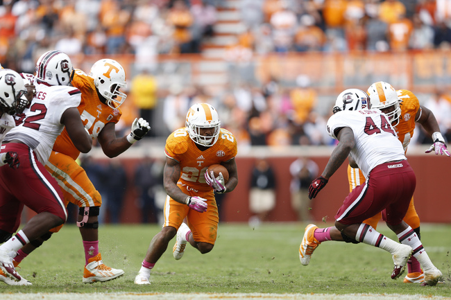 Hi-res-185357623-rajion-neal-of-the-tennessee-volunteers-runs-with-the_crop_650