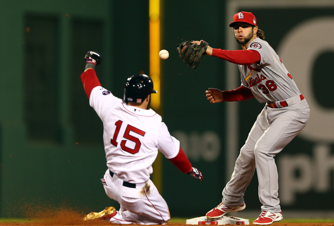 Hi-res-185669446-pete-kozma-of-the-st-louis-cardinals-drops-the-ball-as_crop_650x440