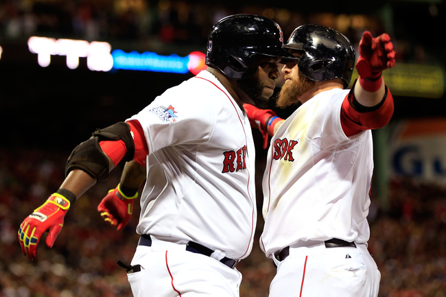 Hi-res-185680970-david-ortiz-of-the-boston-red-sox-celebrates-with-jonny_crop_650