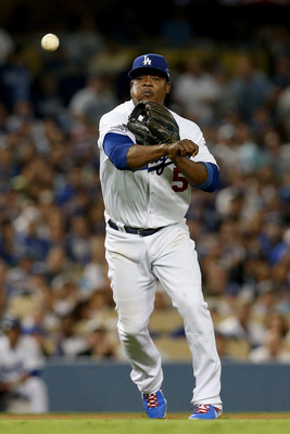Hi-res-184634987-juan-uribe-of-the-los-angeles-dodgers-throws-out-adam_display_image