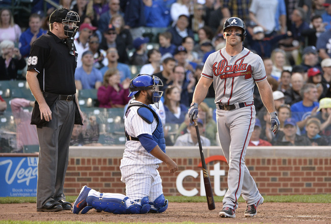 Hi-res-181477029-dan-uggla-of-the-atlanta-braves-walks-back-to-the_crop_650x440